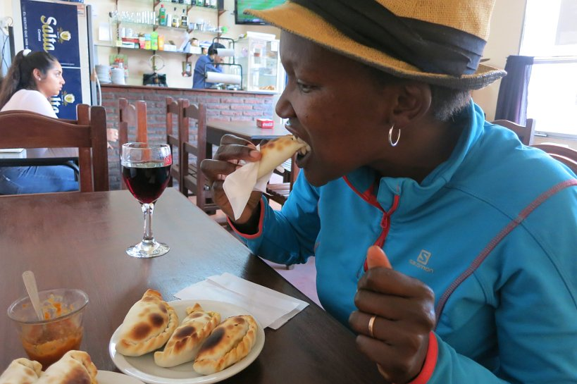 Rosemary eating empanadas at la Tacita in Salta Argentina by Authentic Food Quest