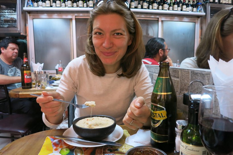 Claire eating Chilean Crab Casserole by Authentic Food Quest