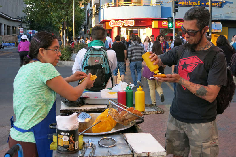 Sopaipilla street stand serving popuar chilean food Authentic Food Quest
