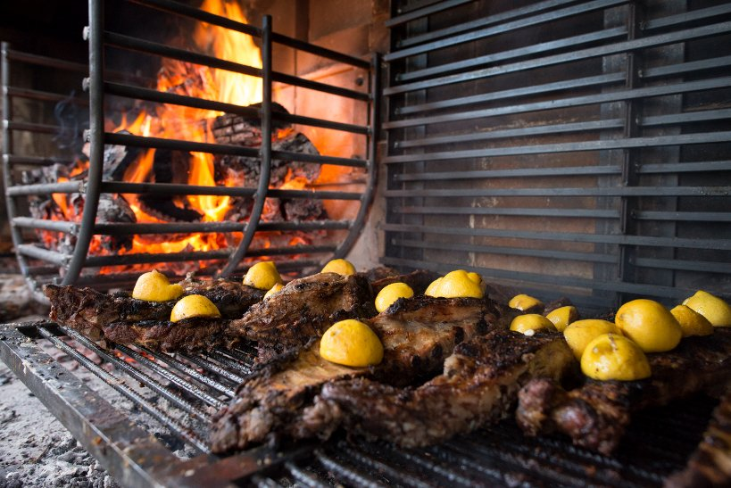 Argentinian grilling with meat cooking slow on the grill