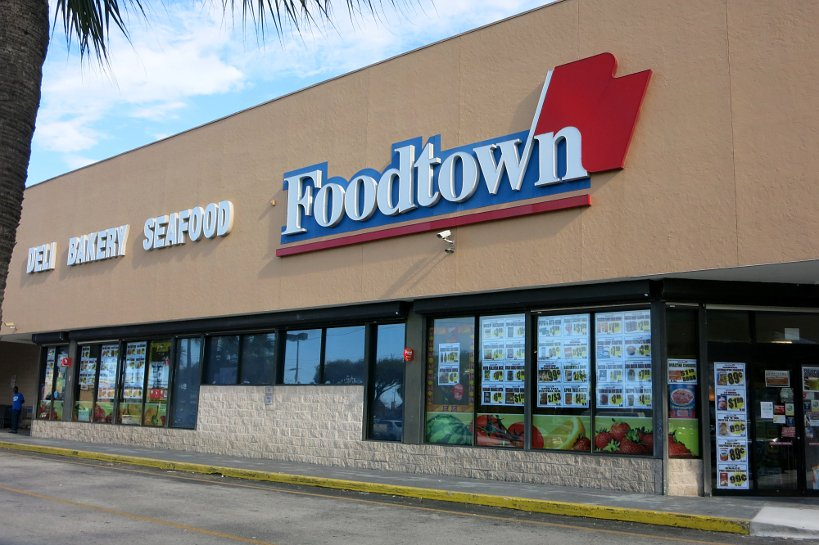 Food town entrance local food stores authentic food quest Food Travel Experiences