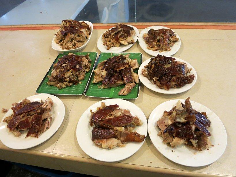 Plates of Rico's spicy lechon cebu lechon authentic food quest