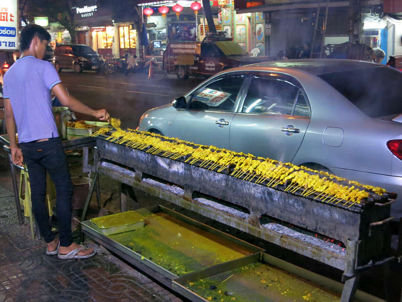 Satay grilling on the streets of Bangkok at night with Expique