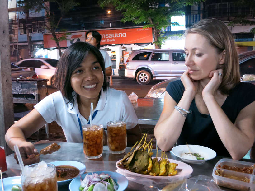 Bangkok at night with Expique eating pork satay and chicken liver by authentic food quest