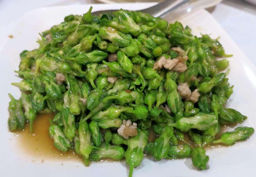 stir fried thai flowe bangkok a tnight authentic food quest