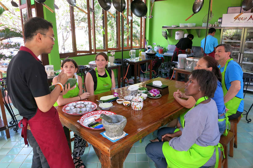 "Chef ""O"" demonstrating green papaya salad Chiang Mai cooking class Authentic Food Quest"