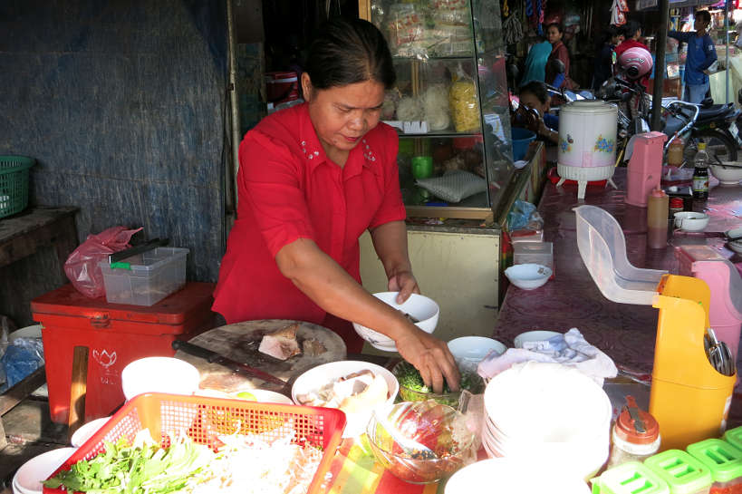 Lady foodstall Pho Langka Market Cambodian Cuisine Authentic Food Quest