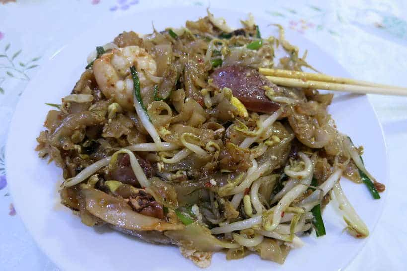 Char Kway Teow for Food in Singapore by Authentic Food Quest. This is one of our favorite dishes and the most popular dish in Singapore. It is available at any of the best local restaurants. This food guide Singapore tells you where to eat in Singapore and what to eat in Singapore 2018