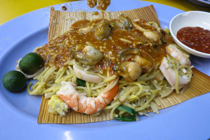 Hokkien Mee for Food in Singapore by Authentic Food Quest. This famous local food Singapore is available at most hawker centers. It is what people eat in Singapore