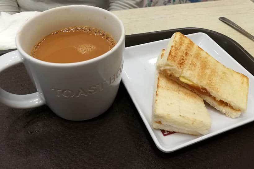 Kaya Toast for Food in Singapore by Authentic Food Quest. How to order local Singapore coffee is quite easy with the ordering coffee map at Toast Box. Singapore coffee is a local favorite. It is one of the famous local foods in Singapore
