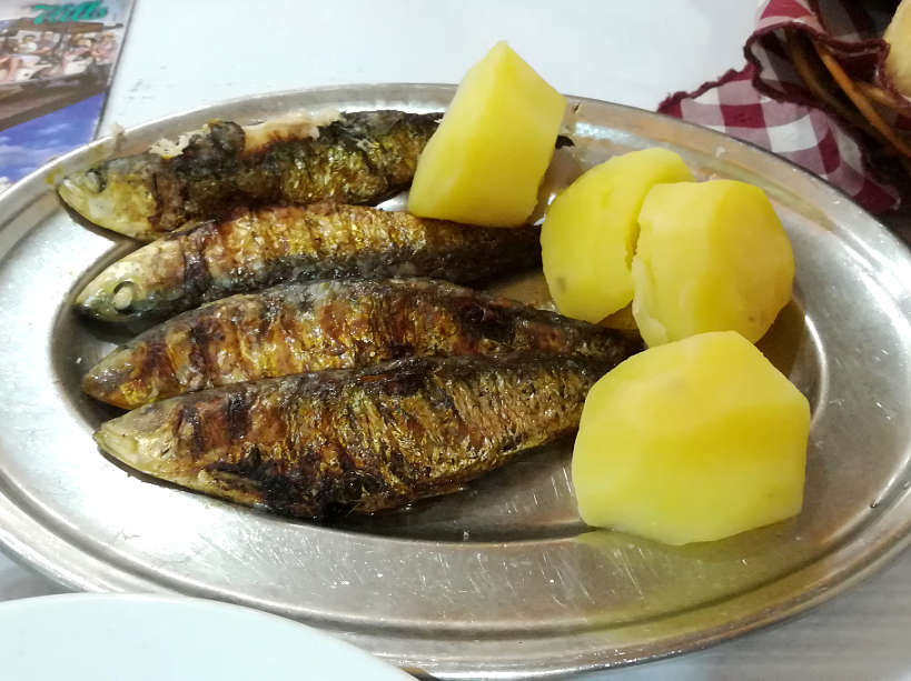 Sardinhas food in Portugal for grilled Portuguese sardines and Portuguese dishes Authentic Food Quest