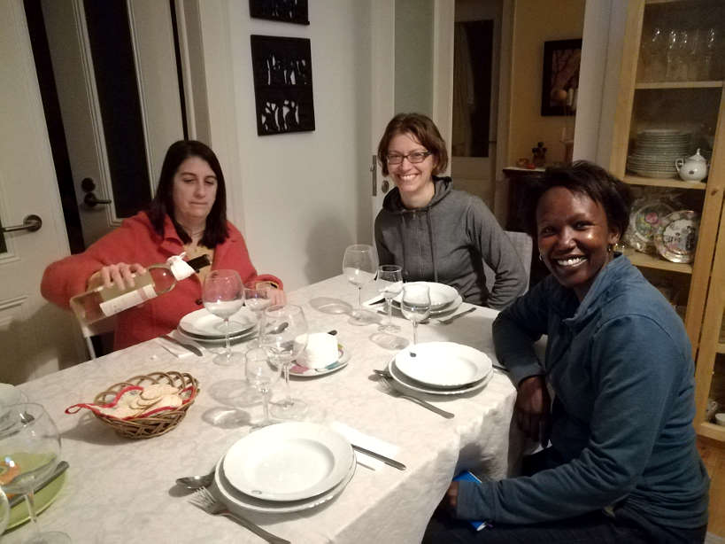 Cristina Claire and Rosemary at Dinning Table for Portuguese food for Portuguese Dinner and Eating with a Portuguese family by Authentic Food Quest