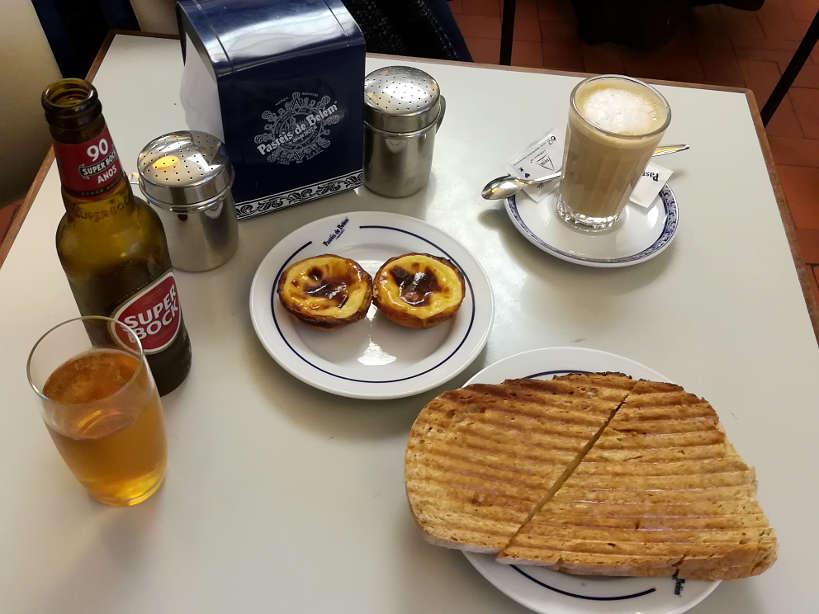 Pasteis de Belem with Tostadas for lisbon restaurants where locals eat the best lisbon food by Authentic Food Quest