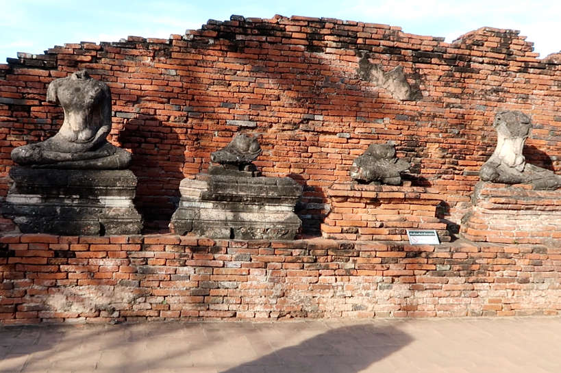 Wat Chaiwatthanaram Headless Buddha images seen on Ayutthaya Day Tour by Authentic Food Quest. Visiting Ayutthaya temples is one of the many things to do on you day trip to Ayutthaya