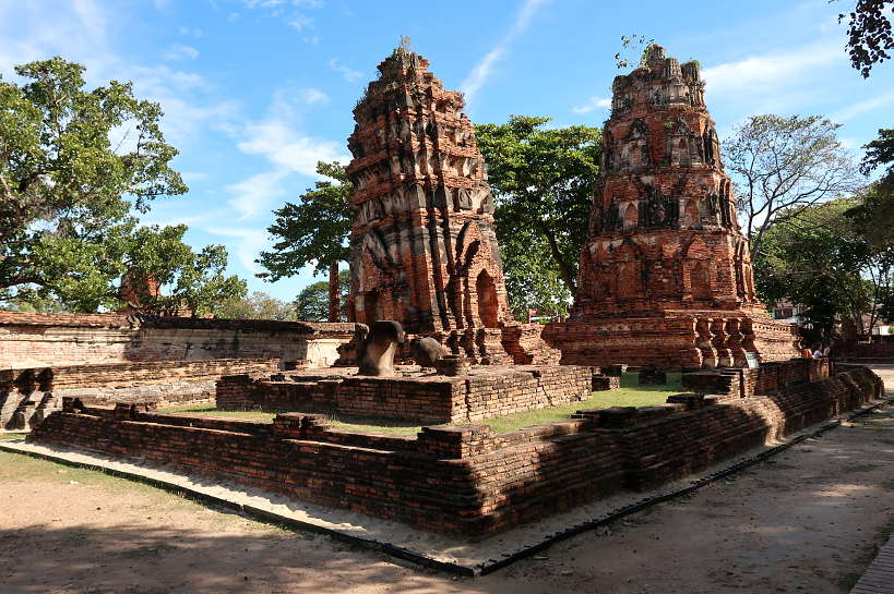 Wat Mahathat Tilted Tower for Ayutthaya Day Tour by Authentic Food Quest. Visiting Wat Mahathat Ayutthaya is a fascinating display of prangs and Buddha images. A great day trip from Bangkok