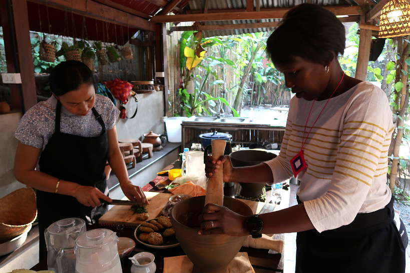 Rosemary Pounding with Kheo at Cooking Class Luang Prabang by Authentic Food Quest