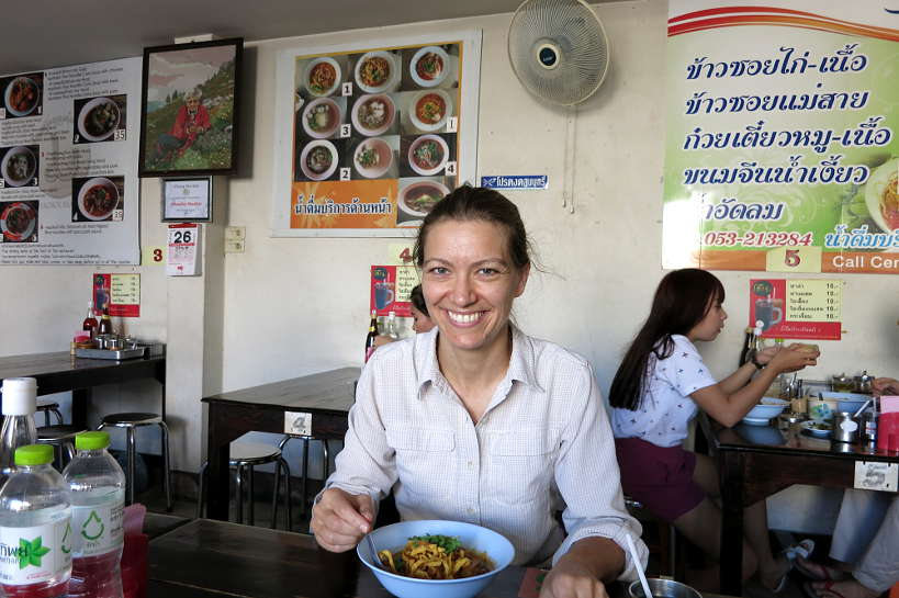 Claire eating at Khao Soi Mae Sai for Best Restaurant in Chiang Mai by Authentic Food Quest