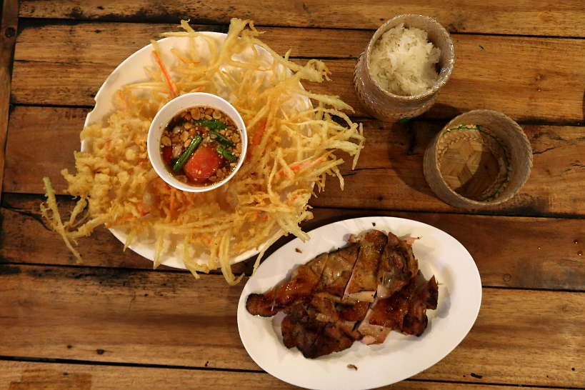 Fried Papaya Salad and Grilled Chicken at Cherng Doi one of the Best restaurants in Chiang Mai by Authentic Food Quest
