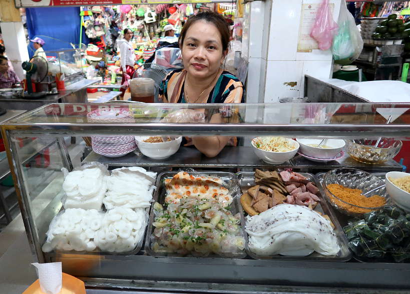 First stop on our Danang Food Tour Market Vendor Selling Banh Beo Uot Thap Cam by Authentic Food Quest