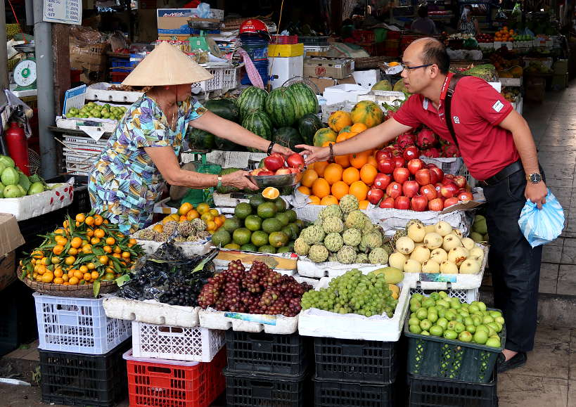 Fruit Vendor Outside Cho Con Market Danang by Authentic Food Quest