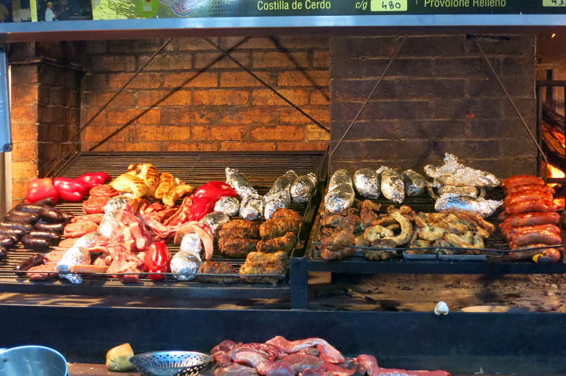An asado in Uruguay with different cuts of meat is one of the best south american food experiences by Authentic Food Quest