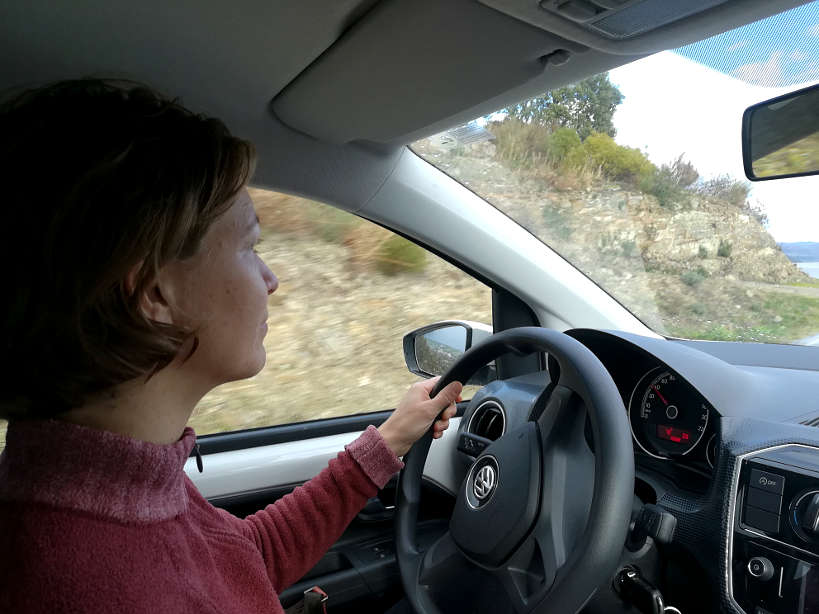 Claire driving car rental in Portugal for Allianz Travel Insurance