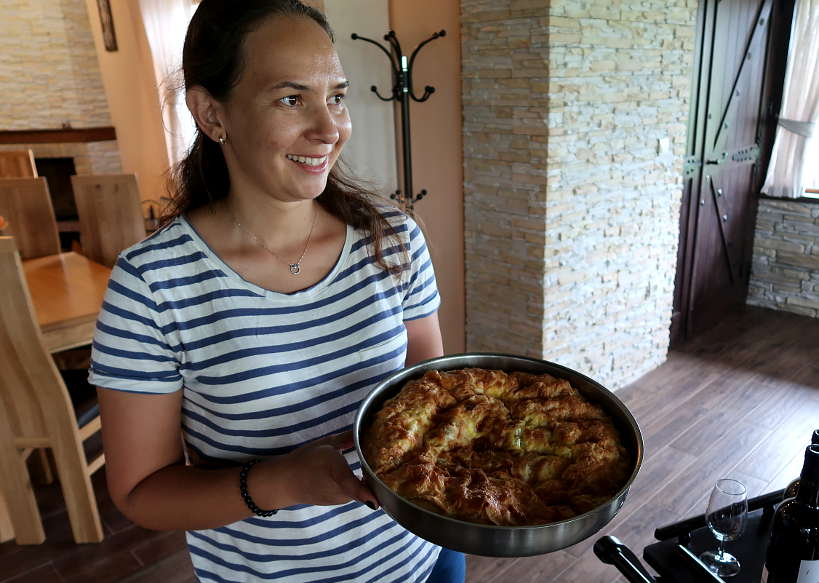 Anita Serving Banitza at Rupel Winery in Melnik Bulgaria by Authentic Food Quest