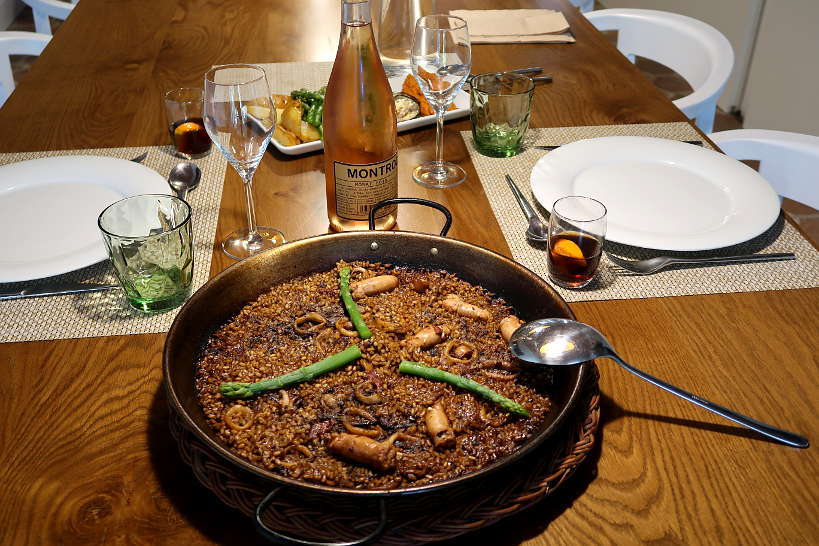 Eating a delicious Paella after Taking a Cooking Class in Spain by AuthenticFoodQuest