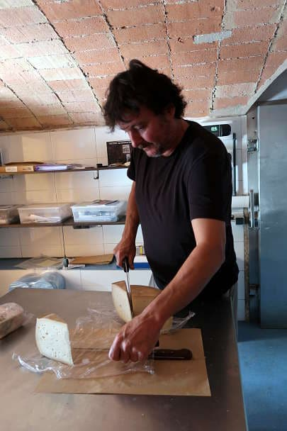 Marti Cutting Goat Cheese Mas Alba Girona Spain by AuthenticFoodQuest