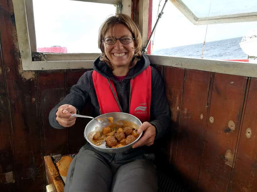 Claire eating Lunch on a Palamos Boat by AuthenticFoodQuest