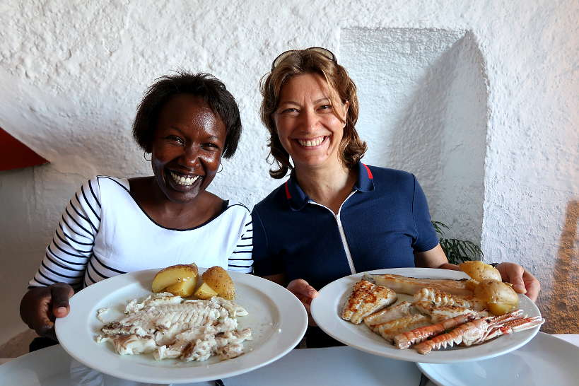 Rosemary and Claire eating grilled fish at Es Baluard Restaurant in Cadaques Costa Brava by AuthenticFoodQuest