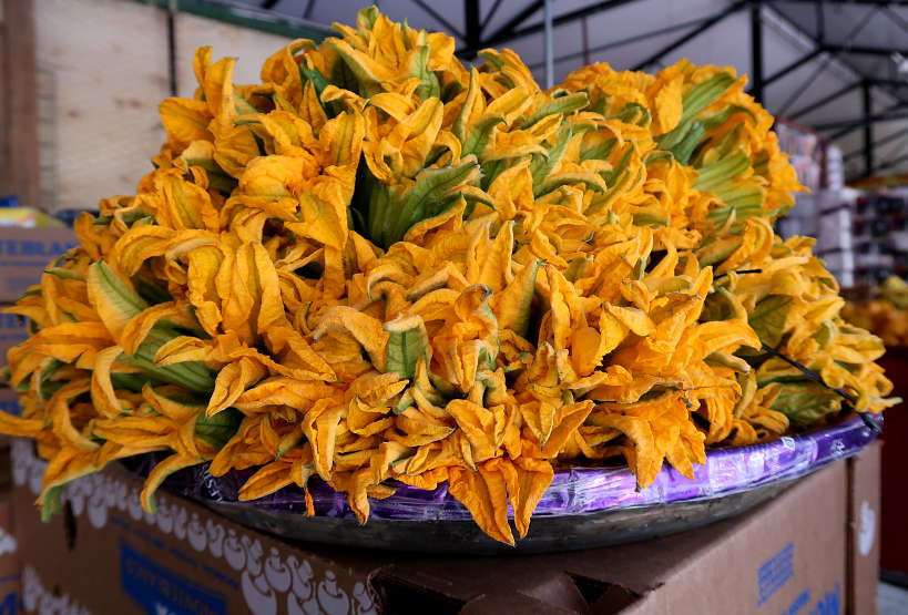 Flor de Calabaza at a food Market in MexicoCity by AuthenticFoodQuest