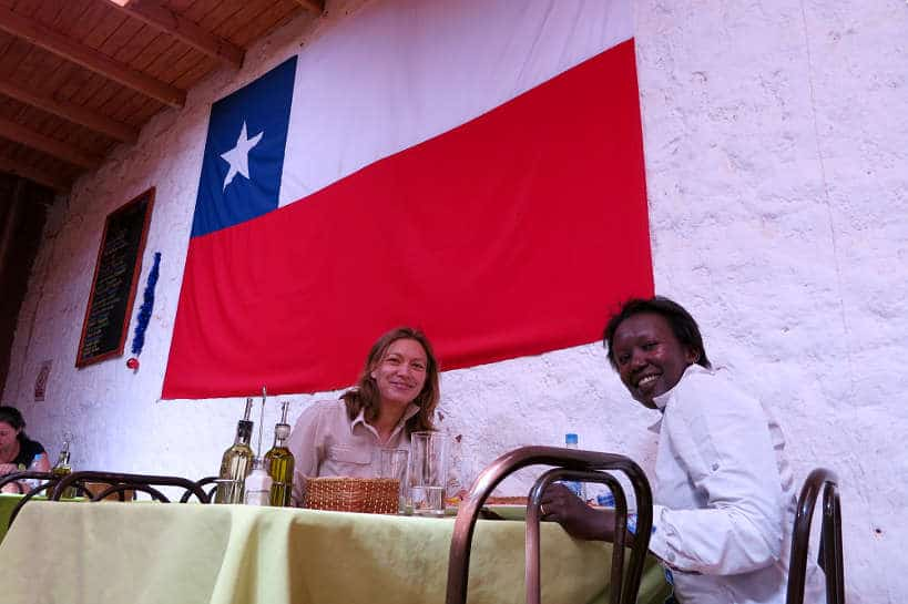 Claire and Rosemary eating pebre in Chile by Authentic Food Quest