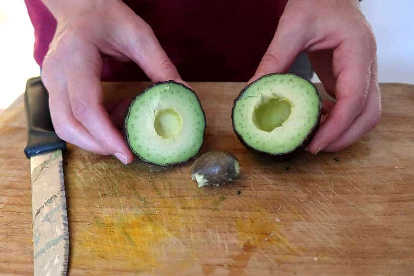 Avocado cut in half by Authentic Food Quest for Mexican gaucamole recipe