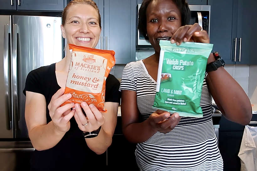 Claire and Rosemary showing off Universal Yums Snacks for Universal Yums Review