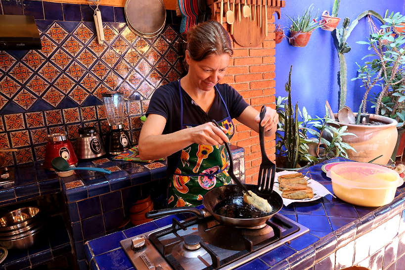 Claire cooking chile rellenos at La Cocina Oaxaquena by Authentic Food Quest