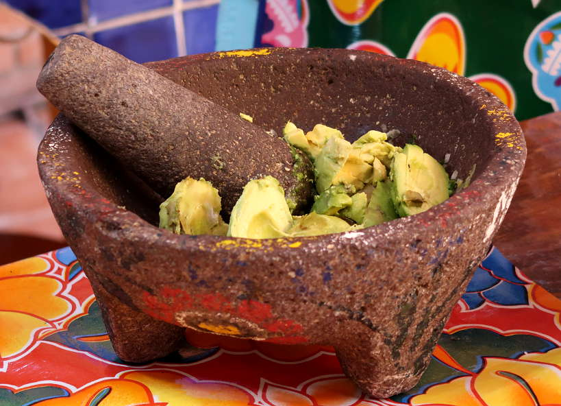 Cooking class in Oaxaca making guacamole by Authentic Food Quest