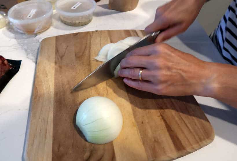 Truffle Shuffle SF cooking Class cutting onions  by Authentic Food Quest for wagyu burger recipe