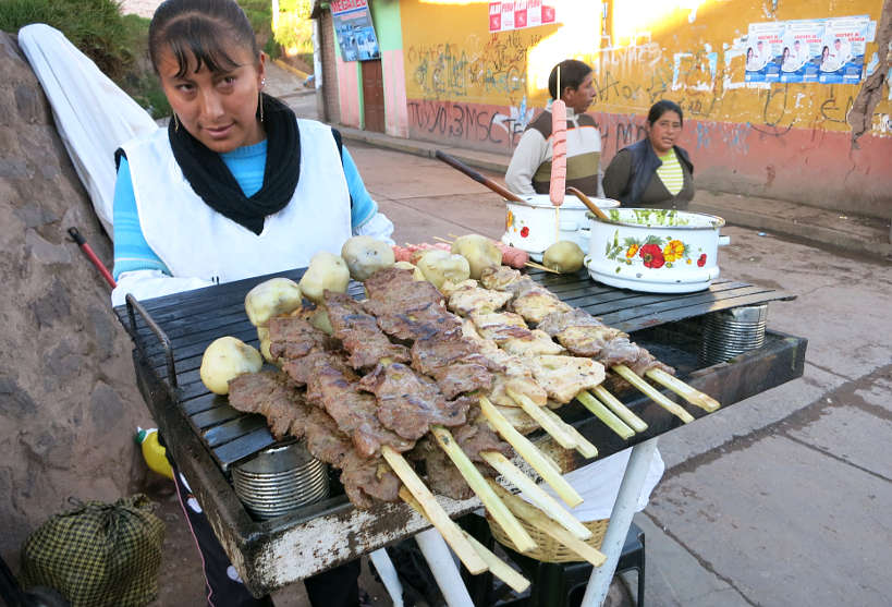 Anticuchos vendor in the street of Cusco by authentic Food Quest