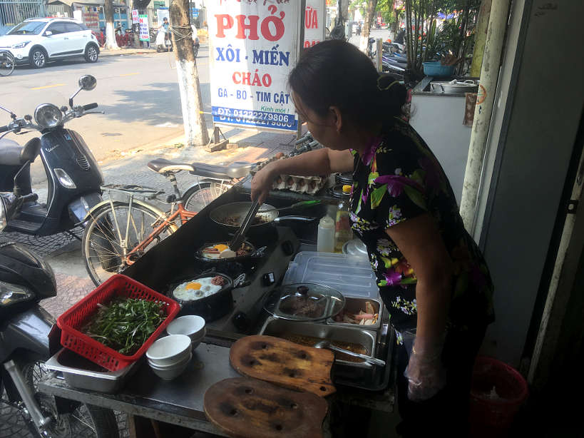 Lady Preparing Bo Ne Danang Breakfast by AuthenticFoodQuest