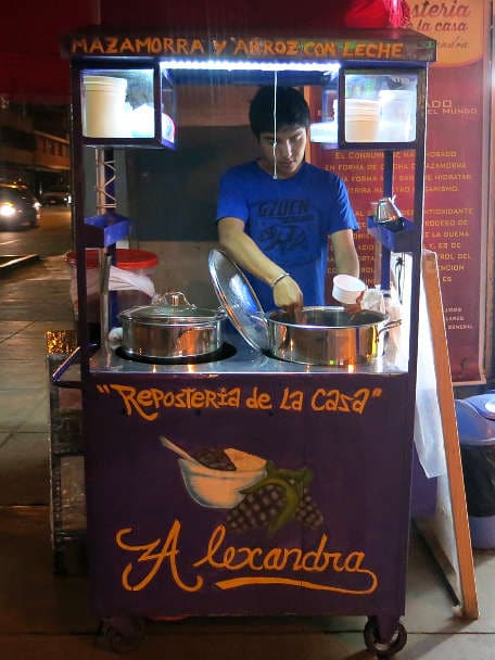 Peruvian vendor selling mazamorra morada in Lima by Authentic Food Quest
