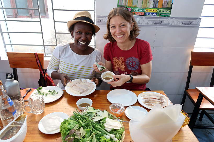 Rosemary and Claire eating Banh Trang Cuon Thit Heo a Danang Food by AuthenticFoodQuest