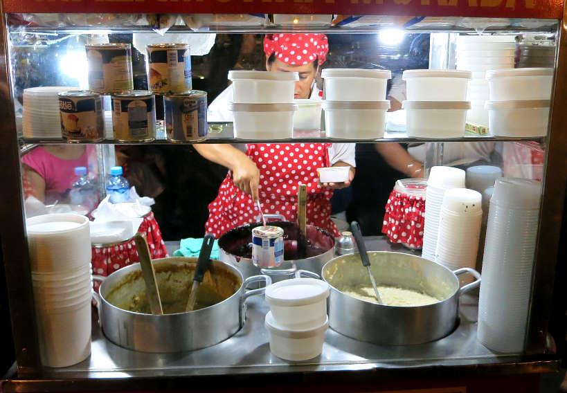 Vendors selling Arroz con Leche Peruvian desserts by Authentic Food Quest