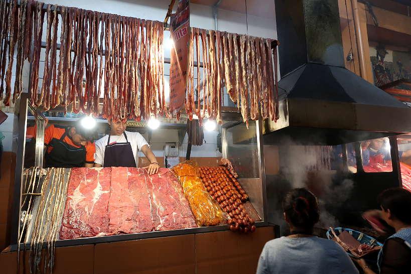 Grilling tasajo at Mercado 20 Noviembre Oaxaca market by Authentic Food quest
