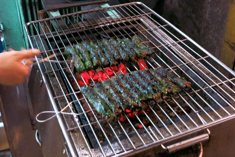 Bo la lot grilling beef in betel leaves for food in Saigon by Authentic Food Quest