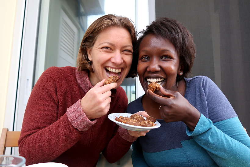 Claire and Rosemary eating Melomakarona by Authentic Food Quest