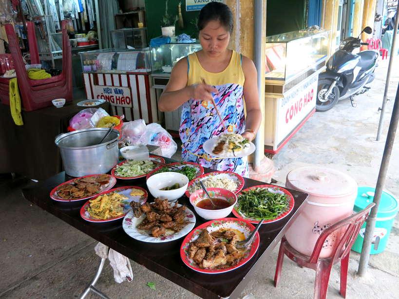 Broken rice com tam street food stand in Vietnam by Authentic Food Quest
