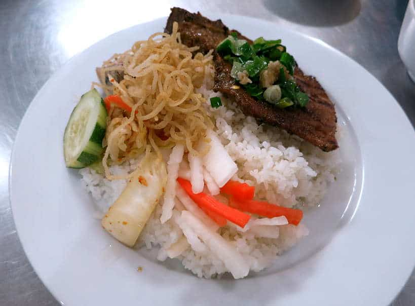 Broken rice pork chop Com tam suon nuong by Authentic food Quest