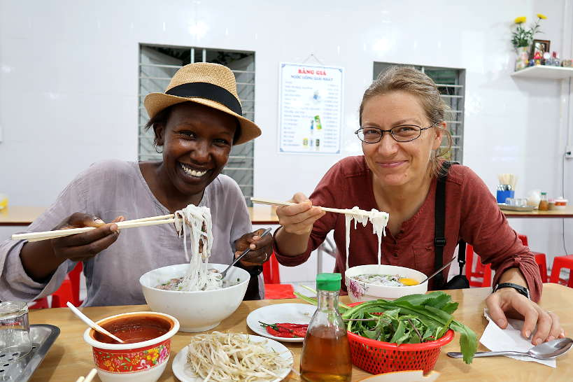 Rosemary and Claire eating pho Vietnam soups in Danang by authentic food quest