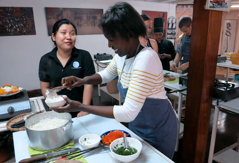 Rosemary learning how to cook broken rice in Saigon Vietnam by AuthenticFoodQuest